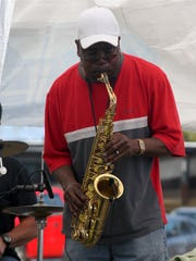 """Bill """"The Duke"""" Ellington of the Island Boy Band solos on his saxophone during the annual Seafood Festival at Tom's Cove Campground in Chincoteague, Va., on Saturday, May 3, 2014."""