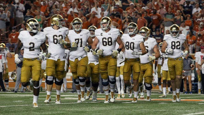 Notre Dame Fighting Irish running back Dexter Williams (2) and offensive lineman Colin McGovern (62) and offensive lineman Alex Bars (71) and offensive lineman Mike McGlinchey (68) and tight end Durham Smythe (80) and tight end Nic Weishar (82) during the game against the Texas Longhorns  at Darrell K Royal-Texas Memorial Stadium.