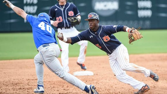 Auburn second baseman Melvin Gray tags out a Kentucky runner. Kentucky avoided the sweep in a 9-6 win on May 1, 2016 at Plainsman Park.
