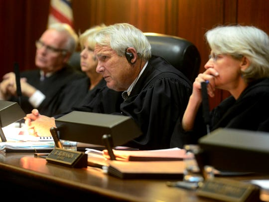 Chief Justice Paul Reiber, center, listens as the Vermont Attorney General's Office presents its case during a public records discussion at the Vermont Supreme Court on June 7, 2017.