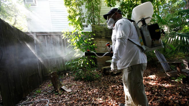Jason Garcia, a field inspector with the Florida Keys Mosquito Control District, tests a sprayer Oct. 4, 2012, that could be used to spray pesticides to control mosquitoes in Key West, Fla. Millions of genetically modified mosquitoes could be released in the Florida Keys if British researchers win approval to use the bugs against two extremely painful viral diseases.