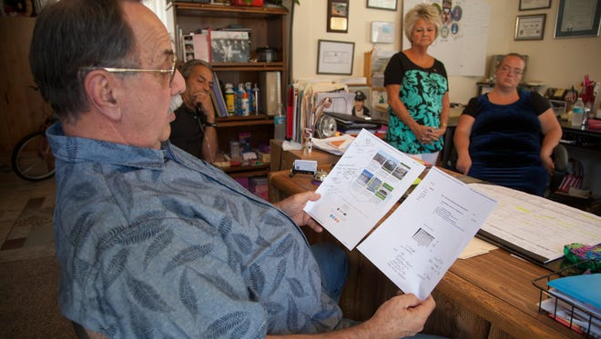Local Vietnam veterans and family members discuss the construction of a new memorial Friday, Aug. 14, 2015.