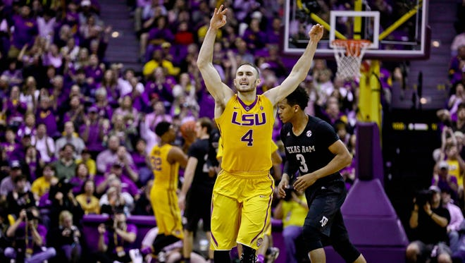 LSU guard Keith Hornsby (4) reacts after hitting a 3-point basket against Texas A&M during Saturday's game at the Pete Maravich Assembly Center. LSU defeated Texas A&M 76-71.
