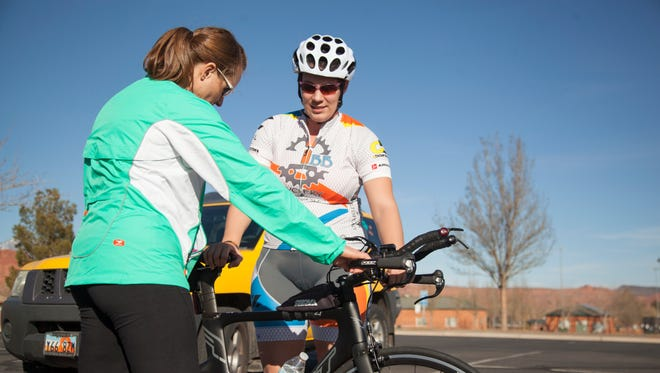 Spectrum audience analyst Casie Forbes trains with experienced cyclist coach Tiffany Gust to practice race technique Friday, Feb. 19, 2016.