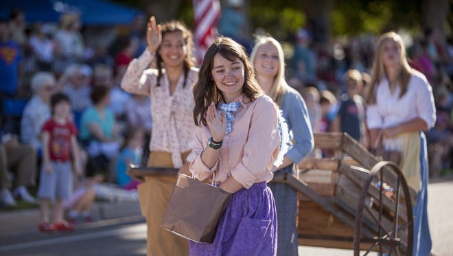 Residents line the streets in Washington City for the 2015 Pioneer Day Parade.