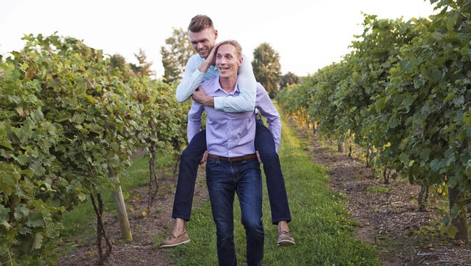 Ryan Bedinghaus, PJ, top, and PJ Painter take a fun stroll through Atwood Hill Winery in Atwood, Ky., for an engagement photo.