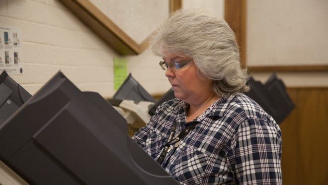 St. George resident Connie Christian votes at the Washington County Administration Building in St. George on Tuesday, June 26, 2018.