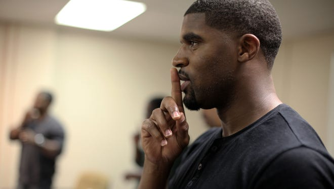 Detroit Lions safety Don Carey participates in a presentation chronicling the timeline of the Old Testament during the Old Testament History, Literature and Theology course on Monday, Oct. 6, 2014 at the Moody Theological Seminary in Plymouth.