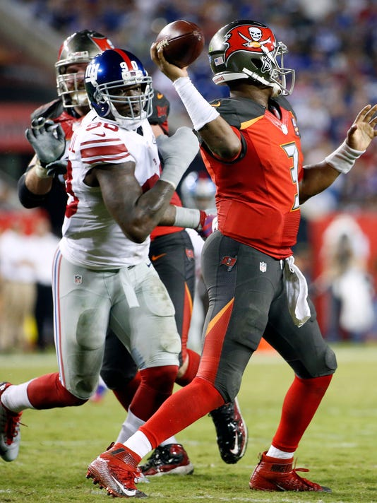 New York Giants defensive end Jason Pierre-Paul (90) pressures Tampa Bay Buccaneers quarterback Jameis Winston (3) during the fourth quarter of an NFL football game Sunday, Nov. 8, 2015, in Tampa, Fla. (AP Photo/Brian Blanco)