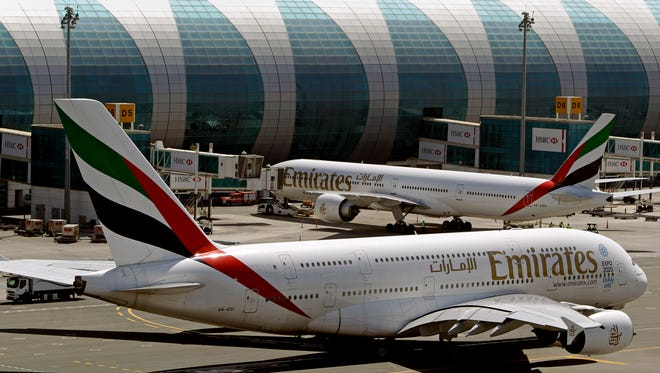 This file photo from May 8, 2014, shows Emirates passenger planes at Dubai airport in United Arab Emirates.