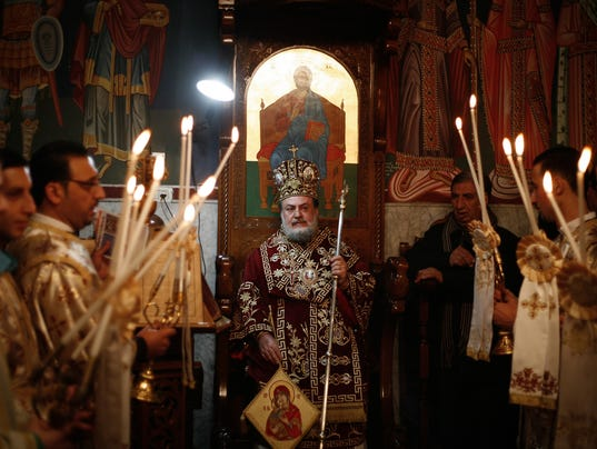 The Orthodox Christian priest heads the celebration  of