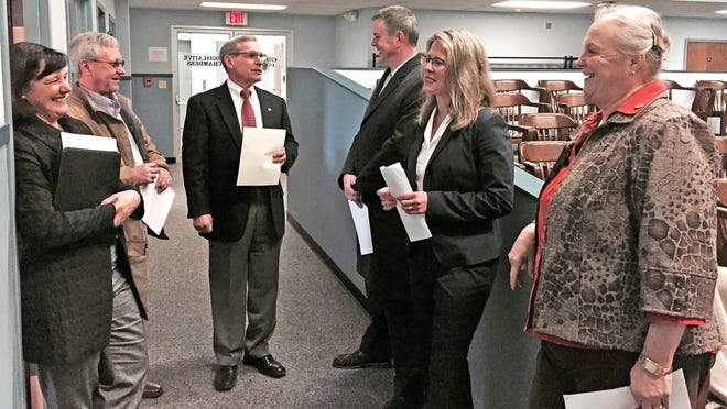 Government officials for the City of Elmira and Chemung County gather Wednesday morning in the Hazlett Building before announcing a new shared services agreement.