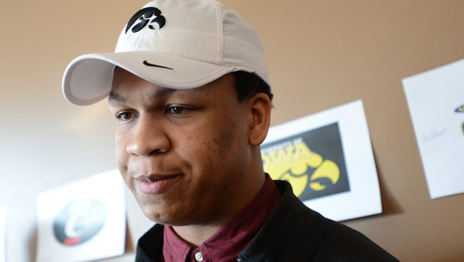 Alaric Jackson from Detroit Renaissance signs with Iowa during National Signing Day on Wednesday at a PSL event in Detroit.