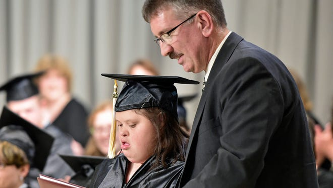 Nia Adams gets her diploma from Daniel Watkins. Franklin Learning Center held commencement Wednesday evening, May 25, 2016.