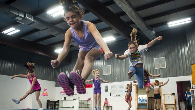 Alayna Haglune, 10, practices jumps with classmates at Cheer Fitness. Owner Becky Acra worked with the city of Great Falls Planning and Community Development personnel to obtain a Safety Inspection Certificate, which is required to operate a business in the city limits.