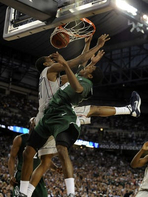 A photo for the ages. Rod Sanford captured this slam dunk from MSU's Durrell Summers in 2009 during the Final Four at Ford Field. MSU's Durrell  Summers slams home a dunk over Connectcut's Stanley Robinson durng their Final Four game Saturday April 4, 2009.  (photo by Rod Sanford)  Photo Gallery