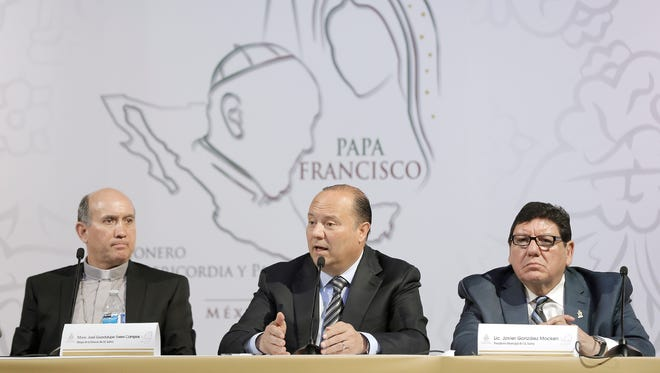 Current Chihuahua Gov. Cesar Horacio Duarte Jaquez, center, is shown with Juarez Bishop Monsignor Jose Guadalupe Torres Campos, left, and Juárez Mayor Javier Gonzalez Mocken at a news conference on the pope's historic visit to Juárez. Six candidates are competing to replace the governor in the June 5 election.