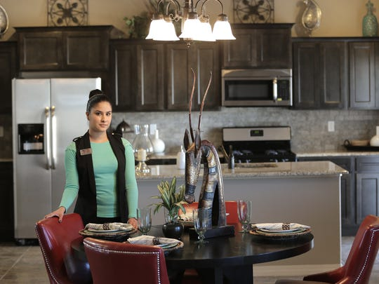 Yvette Delgadillo, builder rep for Classic American Homes, stands in the kitchen of a model home on Hunters Grove in far East El Paso.  Classic American was the top-selling El Paso home builder in 2015.