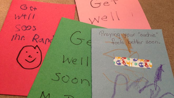 Pre-school students at Vaughn Forest Church made get well cards for member Randy Watson. Others will have a chance to make cards and sign posters at a prayer service tonight at 6 p.m.