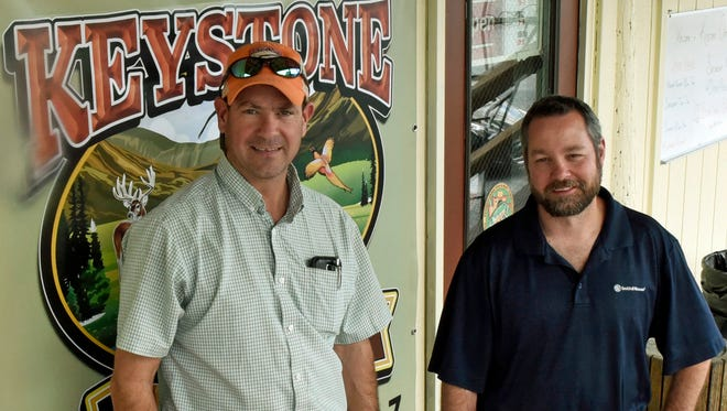 Hunter Webster, right, and his manager, Jeromy (cq) Dinsmore, photographed Monday, October 17, 2016, at Keystone Outdoors store at 186 Path Valley Road, Fort Loudon. Webter is the store's new owner