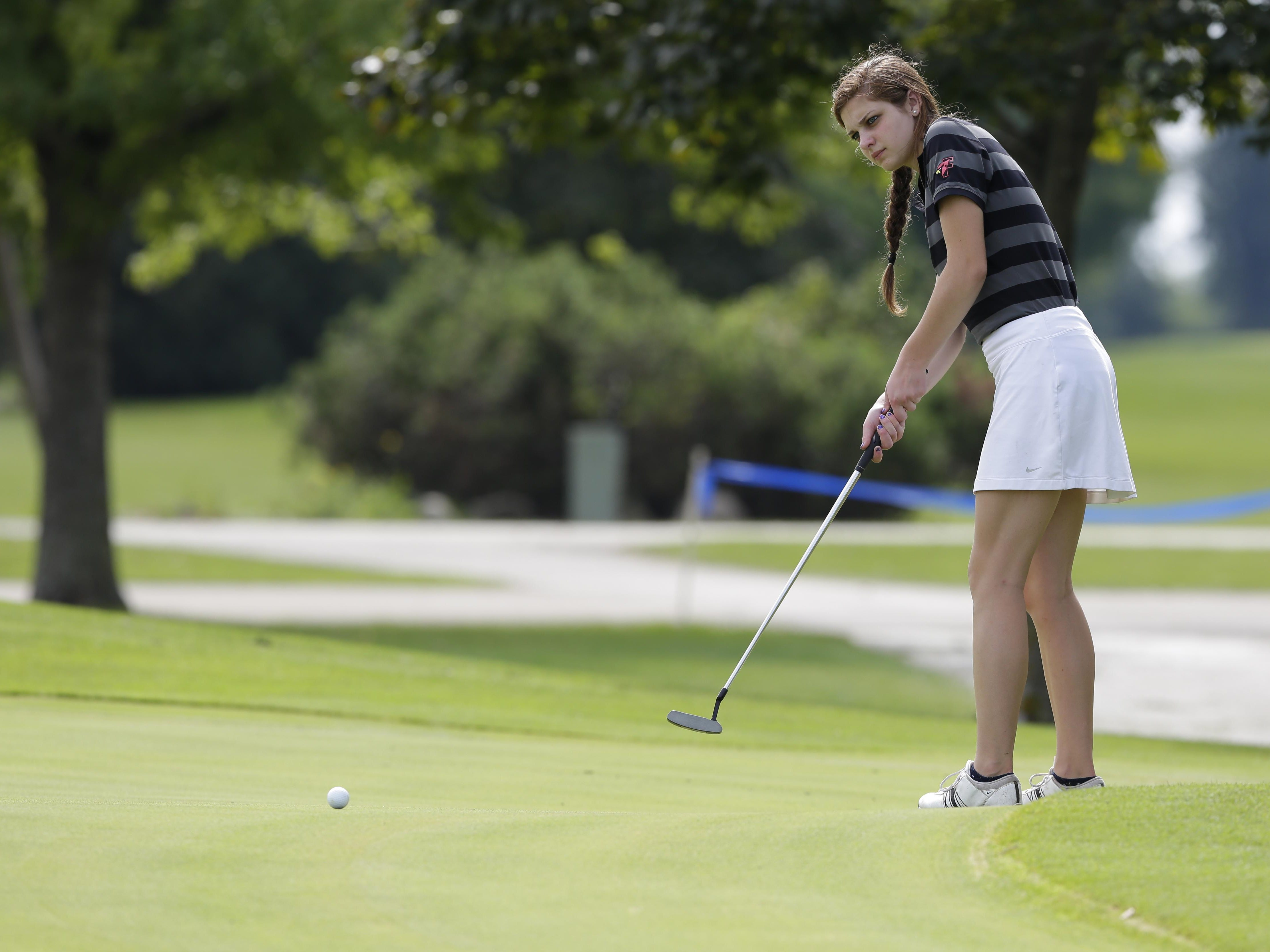 Fond du Lac's Sydney George attempts a long putt during the FVA conference golf meet held at Lake Breeze Golf Course in Winneconne.