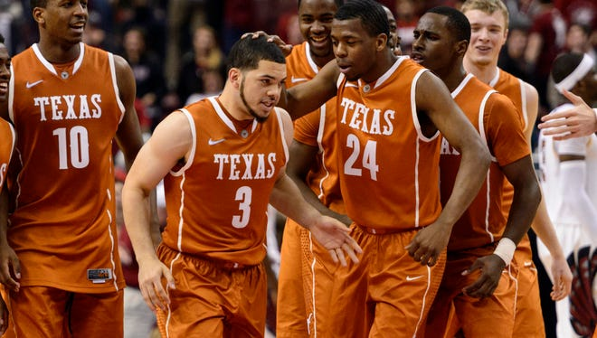 Texas Longhorns guard Javan Felix celebrates with teammates after hitting the game winning shot during overtime against the Temple Owls at the Wells Fargo Center.