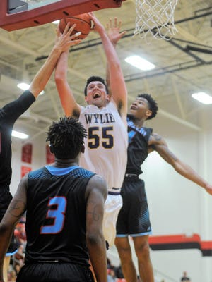 Wylie's Kyle Roberts (55) goes up for a shot surrounded by Hirschi defenders during the Bulldogs' 58-52 overtime win in the Region I-4A quarterfinals at Mineral Wells on Tuesday, Feb. 27, 2018.