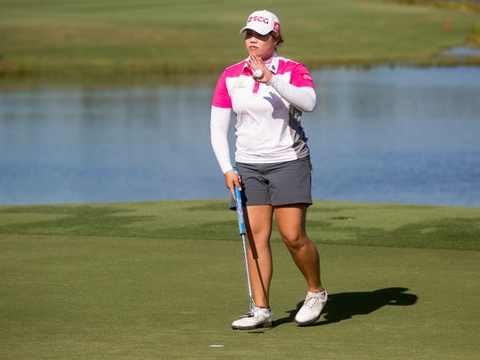 LPGA Tour pro Ariya Jutanugarn acknowledges the crowd after completing a solid day during the third round of the CME Group Tour Championship golf tournament, Saturday, Nov. 18, 2017 in Naples, Fla. Jutanugarn finished the day with a score of ten-under par. (Luke Franke/Naples Daily News via AP)