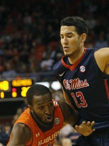 Auburn's KT Harrell's drive is stopped by Mississippi defender Anthony Perez in the first half of their NCAA college basketball game on Saturday, Feb. 7, 2015, in Auburn, Ala.  (AP Photo/Opelika-Auburn News, Todd J. Van Emst)