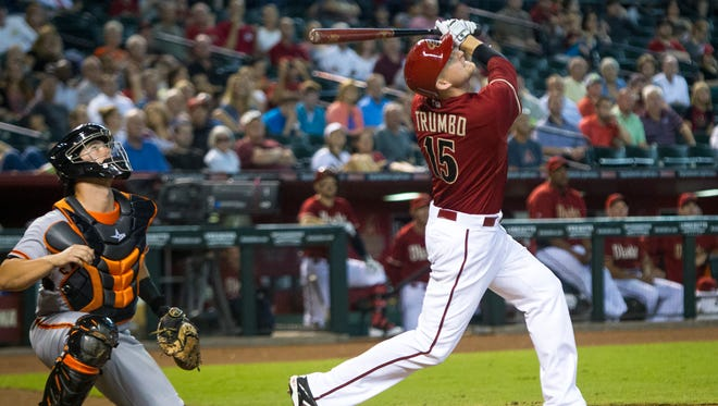 Arizona Diamondbacks' Mark Trumbo and Giants' catcher Andrew Susac watch a high foul ball, as the DBacks play the San Francisco Giants at Chase Field in Phoenix, on Wednesday, Sept. 17, 2014. Trumbo struck out four times as the Giants defeated the D'Backs 4-2.
