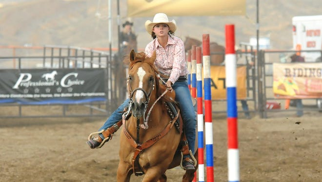 Ally Moreda, here competing in pole bending in the Nevada High School State Finals Rodeo earlier this month in Ely, qualified for nationals.
