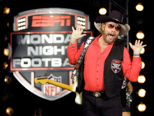 "FILE - In this July 14, 2011, file photo, Hank Williams Jr. performs during the recording of a promo for NFL Monday Night Football in Winter Park, Fla. USA Today Network-Tennessee reported on June 5, 2017, that Williams and his ""All My Rowdy Friends Are Here on Monday Night"" theme are returning to ""Monday Night Football."" (AP Photo/John Raoux, File)"