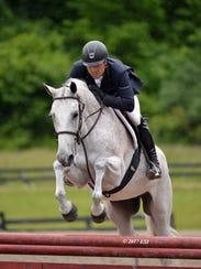 Michael Desiderio is shown riding Zero Tolerance in