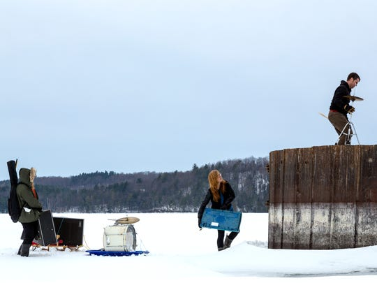 "The band Swale is pictured on Shelburne Bay last winter while recording the video for their song ""Joyless."""