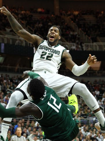 Branden Dawson is fouled by Eastern Michigan forward