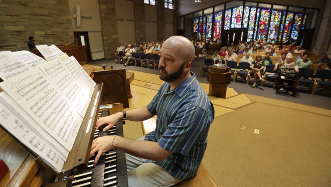 Andrew Birling of Minneapolis plays during the Lunchtime Organ Recital Series on Wednesday at Memorial Presbyterian Church in Appleton. Birling, a graduate of Lawrence University, played on this very same organ as the first performer during the first series 21 years ago. Dan Powers/USA TODAY NETWORK-Wisconsin