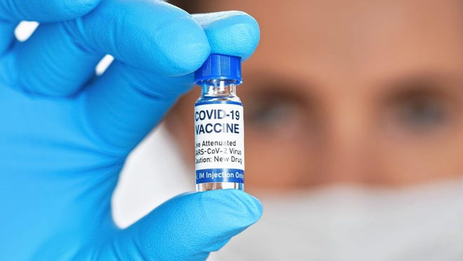States were asked earlier this year to submit a vaccine distribution plan to the CDC by Nov. 1. A preliminary draft of Ohio's plan shows the state would roll out a COVID-19 vaccine in four different phases, with health care workers getting the shot first.