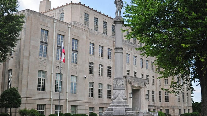 A Confederate monument stands on the grounds of the Sebastian County Courthouse on Tuesday, June 9, 2020 in Fort Smith. The statue is more than 30 feet tall including a 6 foot Confederate Army soldier on top. The statue was placed in 1903 and listed on the National Register of Historic Places in 1993.