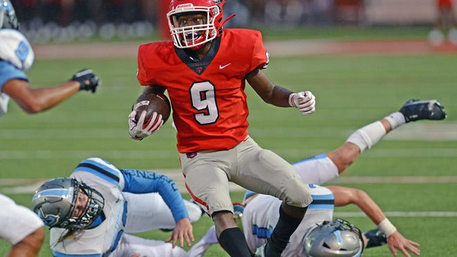 Northside's Tyheen Prosise heads up field after a reception in the first quarter against Southside on Thursday at Mayo-Thompson Stadium. Northside won the season opener 35-7.