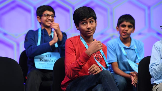 May 31, 2018; National Harbor, MD, USA; Jashun Paluru from Indiana reacts after a video featuring him is shown and he gets up to spell  the word amaranthine (fadeless, undying) correctly during the evening session of the 2018 Scripps National Spelling Bee at the Gaylord National Resort and Convention Center. Mandatory Credit: Jack Gruber-USA TODAY NETWORK