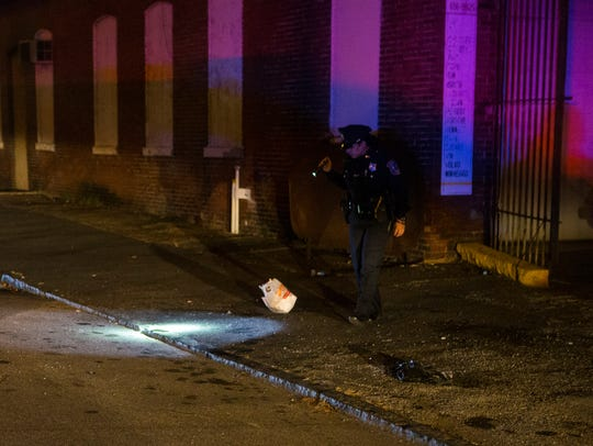 Police investigate a shooting in the 1200 block of