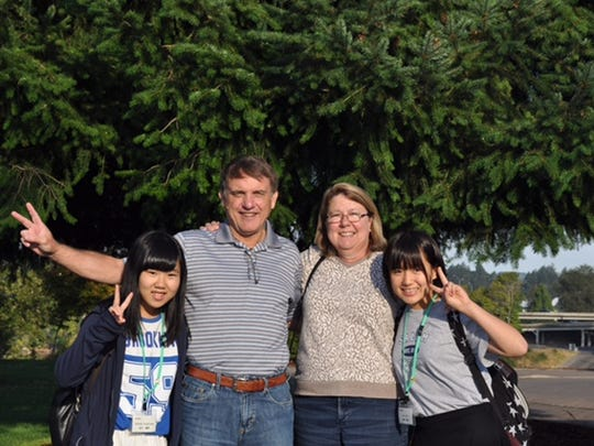 Satsuki Yoshikawa, from left, Bob Wells, Cheryl Wells and Ami Sato pose at Riverfront Park last summer. The Wells hosted two middle school students who were part of Salem-Kawagoe Sister Cities Incorporated's cultural exchange program.