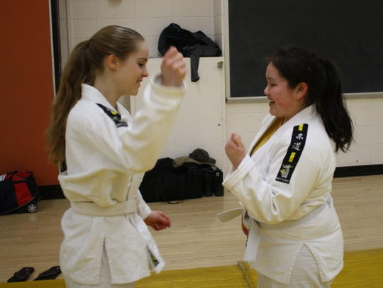 Andrea Zarfl (left) attempting to practice gripping
