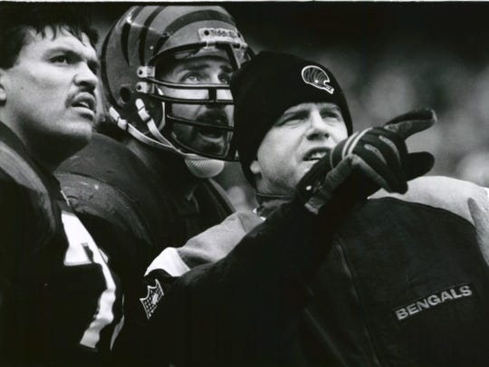 Anthony Munoz, Joe Walter and Boomer Esiason watch a replay of Tim Brown's TD punt return in November of 1991.  The Enquirer/John Curley