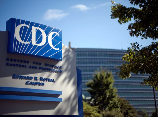 In this Oct. 8, 2013, file photo, a sign marks the entrance to the federal Centers for Disease Control and Prevention,in Atlanta.   Citing an anthrax scare and a recurring problem with safety, the Centers for Disease Control and Prevention on Friday, July 11, 2014,  shut down two research labs and stopped shipping highly dangerous germs to other labs. One of the closed facilities was involved an incident last month that could have accidentally exposed workers in three labs to anthrax. A second, previously undisclosed problem earlier this year involved deadly bird flu.