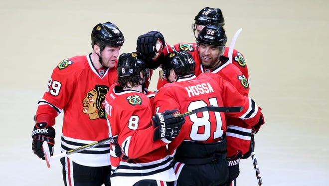 Chicago Blackhawks left wing Bryan Bickell (29) celebrates with teammates after scoring a goal against the St. Louis Blues during the third period in game four of the first round of the 2014 Stanley Cup Playoffs at United Center.
