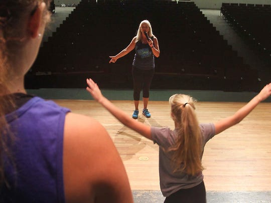 "Robin Dawn gives some instruction during a Dance rehearsal Monday in the auditorium at North Fort Myers High School. Robin Dawn Academy of Performing Arts will celebrate 40 years doing a show titled: ""For the Love of Dance Celebrating 40 years"" at North Fort Myers High School."