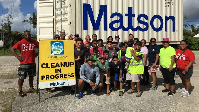 The Guam Giants Youth Football Organization, in conjunction with Matson Navigation's Adahi I Tano' program, cleaned up areas in the village of Mangilao on Oct. 9, 2016.