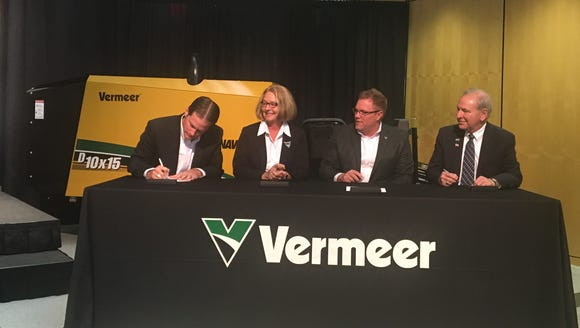 Vermeer President and CEO Jason Andringa signs an agreement