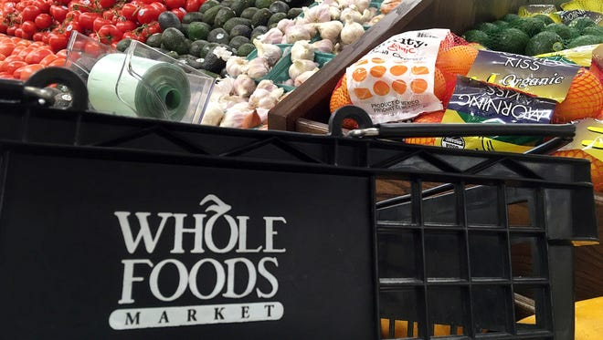 This June 5, 2017, photo, shows produce displayed at Whole Foods Market in Andover, Mass. Amazon is buying Whole Foods in a deal valued at about $13.7 billion. The two companies have not yet detailed how their proposed union might change the experience for customers. But the deal has the potential to boost the outsized ambitions of Amazon CEO Jeff Bezos and Whole Foods chief John Mackey, each of whom has already radically altered the way Americans shop.